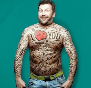 man covered in tattoos depicting past girlfriends