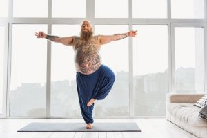 tattoed man on yoga