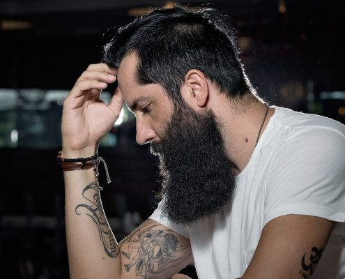 man with tattoo on arm