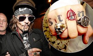 Johnny Depp Greeted by Fans Outside of his Hotel